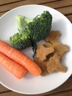 These Organic Carrot & Broccoli Dog Treats Cookies are a really tasty heartfelt treat for your four legged friend - because you love them! Carrot is an excellent vegetable, packed full of vitamin A, which is especially important for eye health.  Also containing Vitamins C, D, E & K; calcium, potassium, magnesium, iron & phosphorus, to name a few minerals and bioflavonoids!  These nutrients support the immune system, so especially important to include in the diet to nourish the body.  Carrots can also help digestion & are virtually fat-free, so great to use in healthy treats. Broccoli contains Vitamins A, C, D & K; chromium, folic acid, fibre, beta carotene, bioflavonoids and high levels of cancer fighting antioxidants.  It is also reputed to offer some protection against some harmful bacteria & viruses & support & nourish the immune system. Choose these nourishing cookies when you need to support your pooch's immunity & promote general good health, including vision. These tasty and crunchy treats are all individually handmade and baked by our professional doggie baker here in the UK. Composition: Organic Strong Wholewheat Flour, Organic Rye Flour, Organic Oats, Organic Carrot, Organic Broccoli, Organic Almond Flour, Organic Peanut Butter, Nutritional Yeast (with added B12), Vegetable Stock, Filtered Water (Contains gluten, wheat & peanuts). Minimum 100g in each bag.